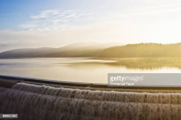 edge of the croton dam reservoir at sunrise - westchester county stock pictures, royalty-free photos & images