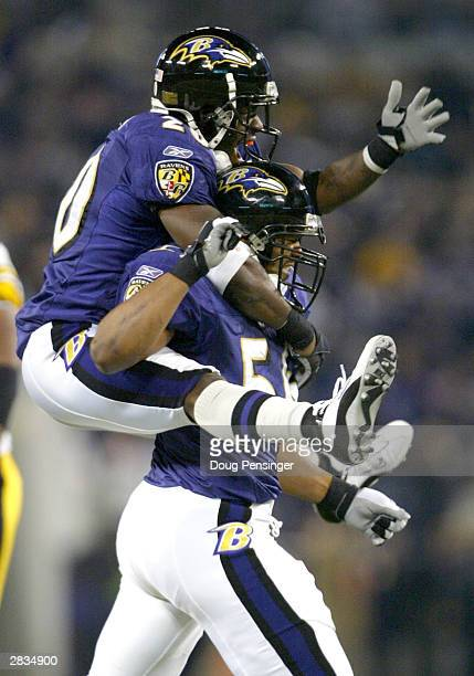 Edgerton Hartwell of the Baltimore Ravens celebrates his sack of Tommy Maddox with teammate Ed Reed as the Ravens defeated the Pittsburgh Steelers...