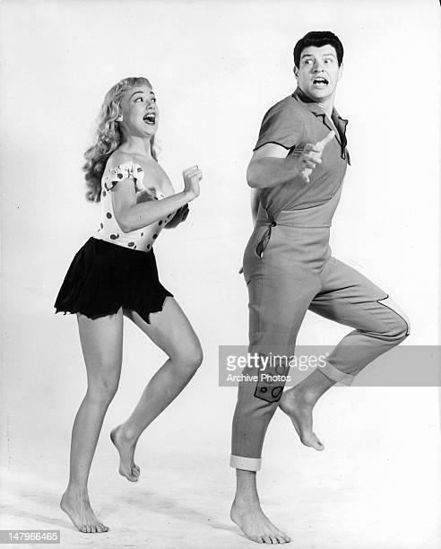 Edie Adams chasing after Peter Palmer in publicity portrait for the Broadway play 'Li'l Abner' 1956