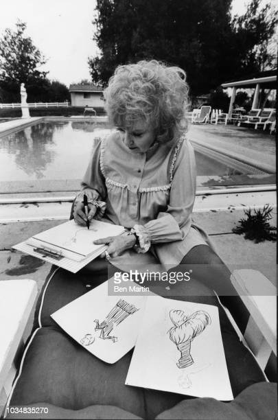 Edie Adams comedienne and singer at her home on an almond ranch sketching fashions for her line of Bonham label party gowns sold at NeimanMarcus...