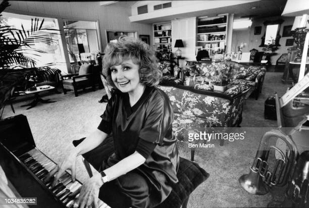 Edie Adams comedienne and singer at the piano in her home on an almond ranch in Bakersfield March 26th 1982
