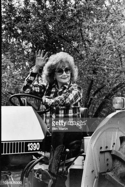 Edie Adams comedienne and singer behind the wheel of a tractor on her almond ranch in Bakersfield March 26th 1982