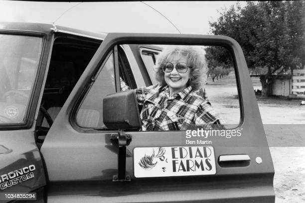 Edie Adams comedienne and singer climbing into a Bronco on her almond ranch in Bakersfield March 26th 1982