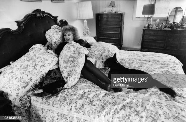 Edie Adams comedienne and singer playing with her dogs in the bed of her home on an almond ranch in Bakersfield March 26th 1982