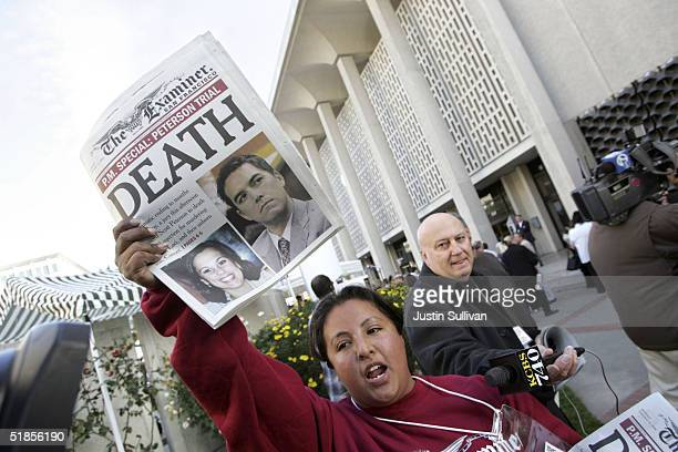 Edie Alejandre a carrier for the San Francisco Examiner hands out copies of the newspaper's special edition which headlines the sentence of death in...