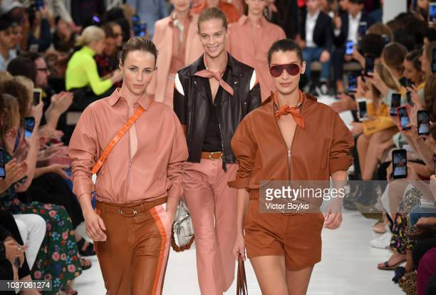 Edie Campbell and Bella Hadid walk the runway at the Tod's show during Milan Fashion Week Spring/Summer 2019 on September 21, 2018 in Milan, Italy.