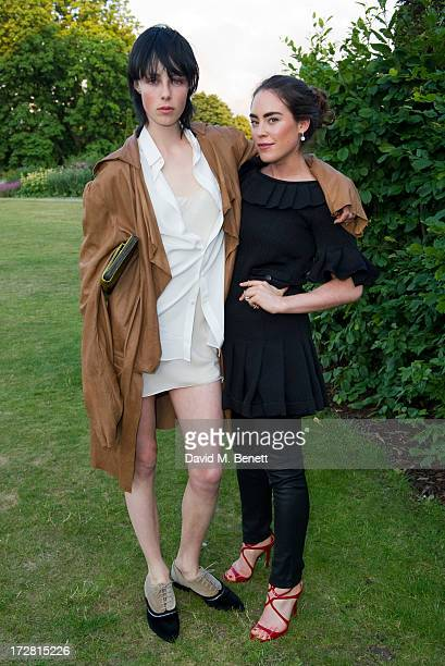 Edie Campbell and Tallulah Harlech attend a private view of 'Fashion Rules' a new exhibition featuring a rare collection of dresses worn by Queen...