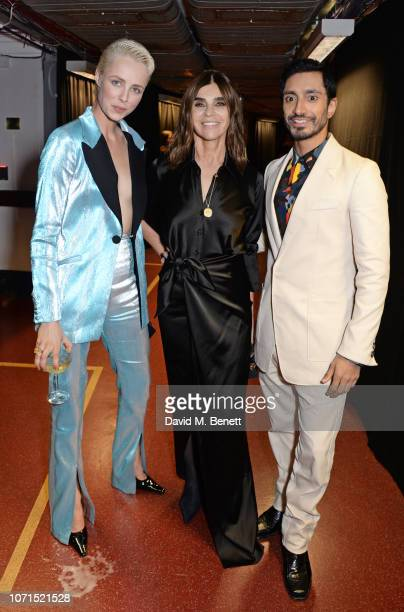 Edie Campbell Carine Roitfeld and Riz Ahmed pose backstage at The Fashion Awards 2018 in partnership with Swarovski at the Royal Albert Hall on...