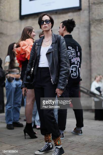 Edie Campbell is seen wearing a Black Leather Jacket at COS during London Fashion Week September 2021 on September 21, 2021 in London, England.