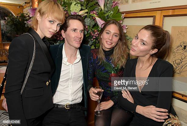 Edie Campbell Otis Ferry Jemima Jones and Quentin Jones attend the dinner hosted by Olivier Rousteing to mark the opening of Balmain's first London...