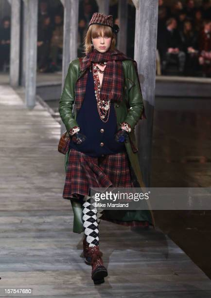 Edie Campbell walks the runway at the CHANEL Metiers d'Art fashion show at Linlithgow Palace on December 4 2012 in Linlithgow Scotland