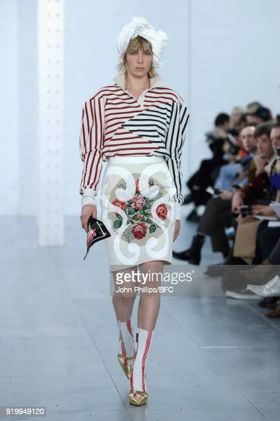 Edie Campbell walks the runway at the Fashion East Symonds Pearmain show during London Fashion Week February 2018 at TopShop Show Space on February...