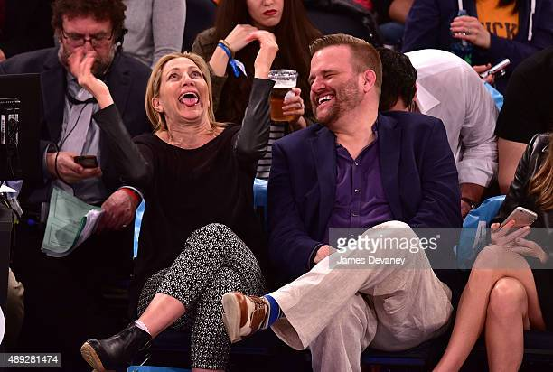 Edie Falco and guest attend Milwaukee Bucks vs New York Knicks game at Madison Square Garden on April 10 2015 in New York City
