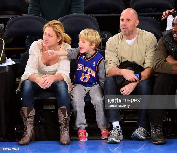 Edie Falco Anderson Falco and Paul Schulze attend the Philadelphia 76ers vs New York Knicks game at Madison Square Garden on November 4 2012 in New...
