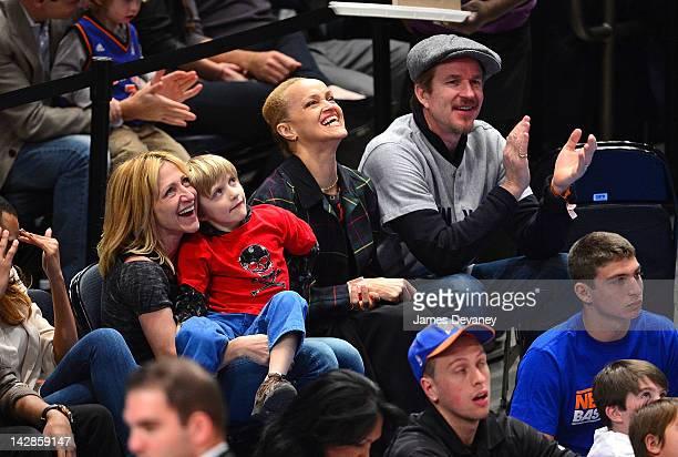 Edie Falco Anderson Falco Cari Modine and Matthew Modine attends the Washington Wizards vs New York Knicks game at Madison Square Garden on April 13...