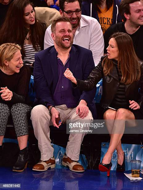 Edie Falco guest and Hilary Swank attend Milwaukee Bucks vs New York Knicks game at Madison Square Garden on April 10 2015 in New York City
