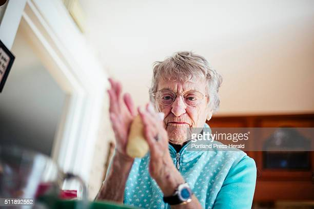 Edie McCormick rolls a log of her pastry dough for her Danish puff pastry at her home in Portland ME on Friday January 22 2016