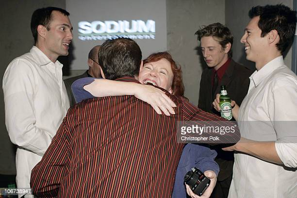 Edie McCurg hugs producer Brady Nasfell center James Haven left and director Mark Edwin Robinson right