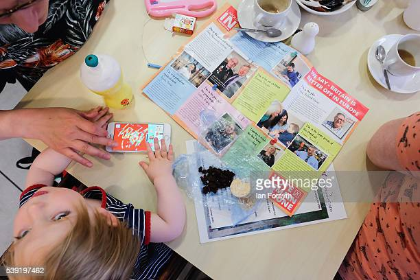 Edie Rowell from Sunderland plays with a game on a phone surrounded by campaign literature as Labour's Shadow Cabinet Minister Gloria de Piero speaks...