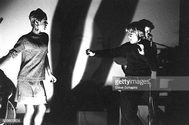 Edie Sedgwick Gerald Malanga and Lou Reed performing with The Velvet Underground during the Exploding Plastic Inevitable tour
