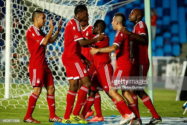 Edier Tello of America de Cali celebrates with teammates after scoring the opening goal during a match between America de Cali and Cucuta as part of...