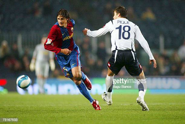 Edilson of Barcelona and Pique of Zaragoza in action during the match between FC Barcelona and Real Zaragoza of Copa del Rey 1/4 finals on January...