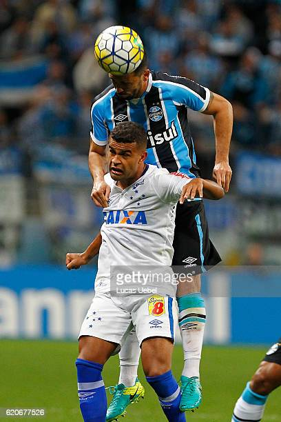 Edilson of Gremio battles for the ball against Alisson of Cruzeiro during the match Gremio v Cruzeiro as part of Copa do Brasil SemiFinals 2016 at...
