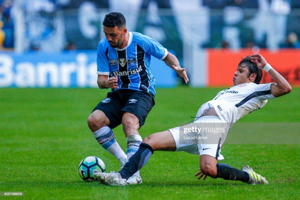 Edilson of Gremio battles for the ball against Angel Romero of Corinthians during the match Gremio v Corinthians as part of Brasileirao Series A 2017, at Arena do Gremio on June 25, 2017, in Porto Alegre, Brazil.