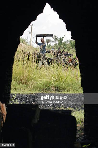 Edimar da Silva loads an oven with wood to produce charcoal in Tailandia Para northen Brazil on February 27 2008 The Brazilian government launched a...