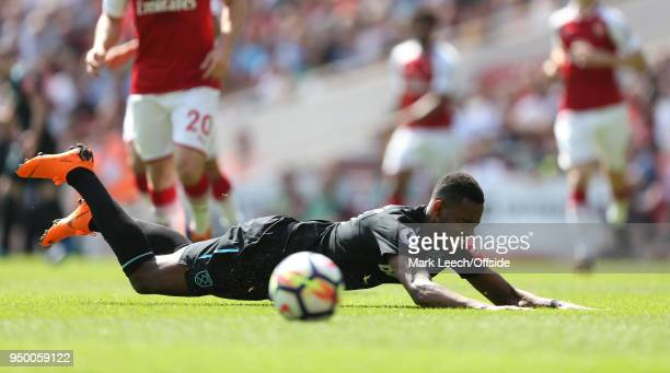 Edimilson Fernandes of West Ham falls as he tries to reach the ball during the Premier League match between Arsenal and West Ham United at Emirates...