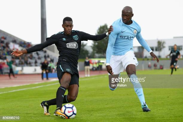 Edimilson Fernandes of West Ham United attempts to cross as Eliaquim Mangala of Manchester City attempts to block during a Pre Season Friendly...