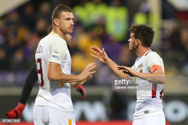 Edin Dzeko and Alessandro Florenzi of AS Roma in action during the Serie A match between ACF Fiorentina and AS Roma at Stadio Artemio Franchi on...