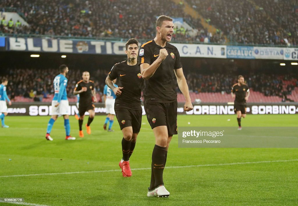 Edin Dzeko and Diego Perotti of AS Roma celebrate after the 1-2 goal scored by Edin Dzeko during the serie A match between SSC Napoli and AS Roma - Serie A at Stadio San Paolo on March 3, 2018 in Naples, Italy.