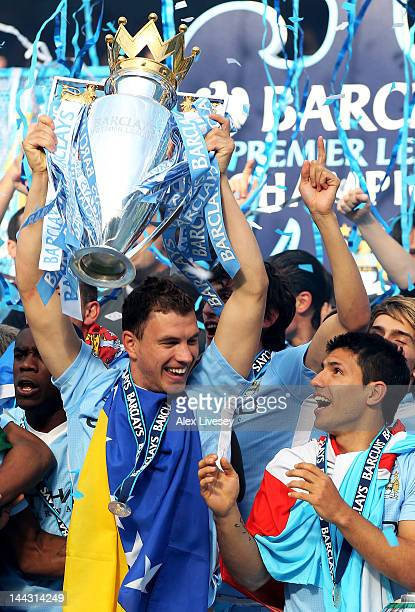 Edin Dzeko and Sergio Aguero of Manchester City celebrate with the trophy following the Barclays Premier League match between Manchester City and...