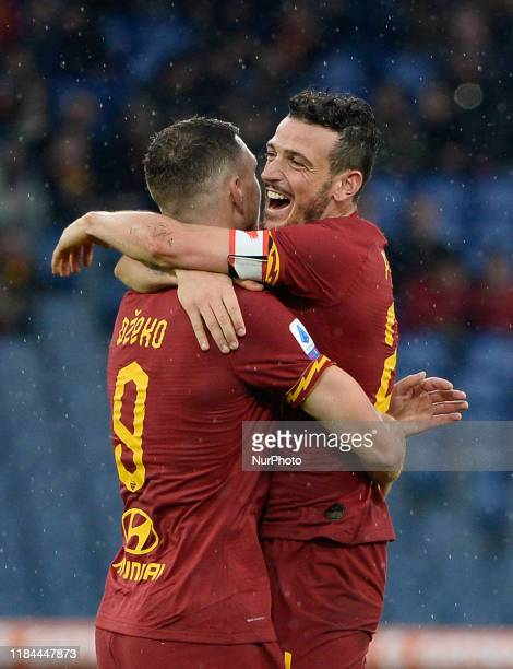 Edin Dzeko celebrates with Alessandro Florenzi after scoring goal 30 during the Italian Serie A football match between AS Roma and Brescia at the...