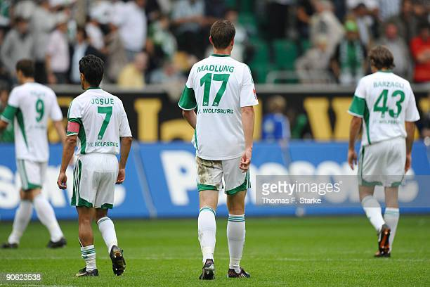 Edin Dzeko, Josue, Alexander Madlung and Andrea Barzagli of Wolfsburg leave the pitch dejected after the Bundesliga match between VfL Wolfsburg and...