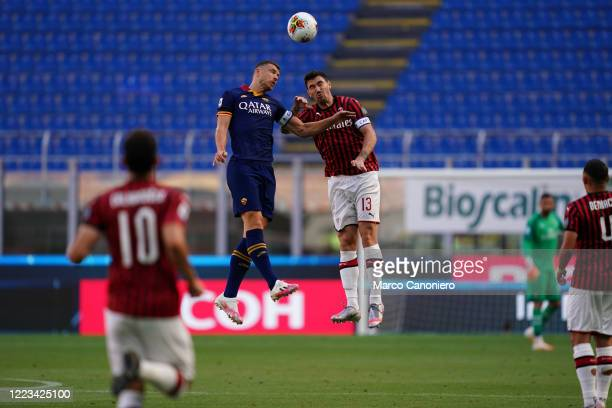 Edin Dzeko of As Roma and Alessio Romagnoli of Ac Milan R in action during the the Serie A match between Ac Milan and As Roma Ac Milan wins 20 over...