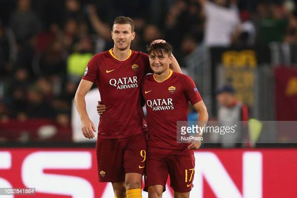 Edin Dzeko of AS Roma and Cengiz Under of AS Roma celebrate the third goal during the UEFA Champions League group G match between AS Roma and PFC...