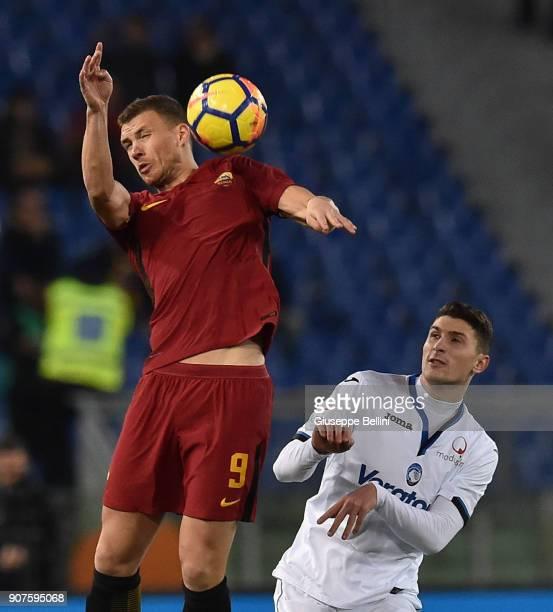Edin Dzeko of AS Roma and Mattia Caldara of Atalanta BC in action during the serie A match between AS Roma and Atalanta BC at Stadio Olimpico on...