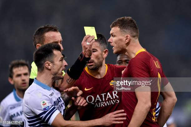 Edin Dzeko of AS Roma argues with Stefan Radu of SS Lazio during the Serie A match between Lazio and Roma at Stadio Olimpico Rome Italy on 2 March...