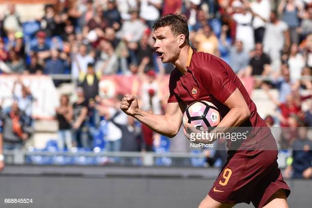 Edin Dzeko of AS Roma celebrate scoring first goal during the italian Serie A match between Roma and Atalanta at the Olympic Stadium Rome Italy on 15...