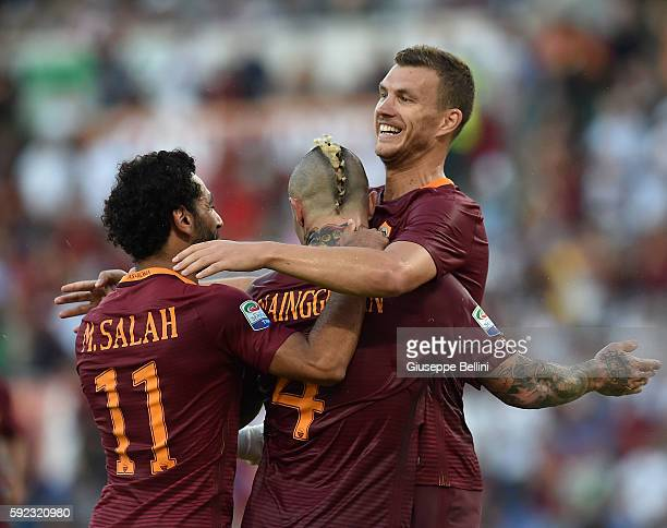Edin Dzeko of AS Roma celebrates after scoring the goal 30 during the Serie A match between AS Roma and Udinese Calcio at Olimpico Stadium on August...