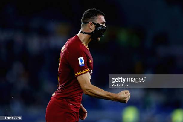 Edin Dzeko of AS Roma celebrates after scoring the opening goal during the Serie A match between AS Roma and AC Milan at Stadio Olimpico on October...