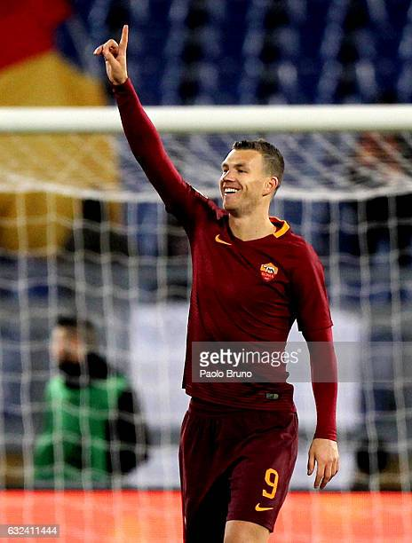 Edin Dzeko of AS Roma celebrates after scoring the opening goal during the Serie A match between AS Roma and Cagliari Calcio at Stadio Olimpico on...