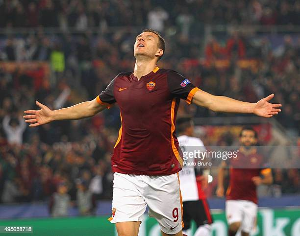 Edin Dzeko of AS Roma celebrates after scoring the team's second goal during the UEFA Champions League Group E match between AS Roma and Bayer 04...