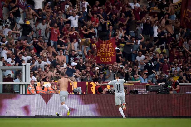 Edin Dzeko (L) of AS Roma celebrates after scoring winning...