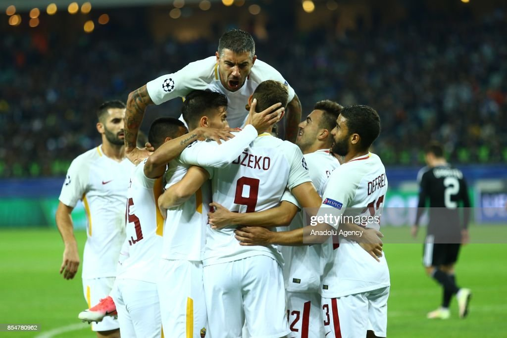 Edin Dzeko (9) of AS Roma celebrates his goal with his team mates during the UEFA Champions League Group C football match between Qarabag FK and AS Roma in Baku, Azerbaijan on September 27, 2017.