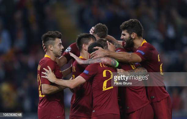 Edin Dzeko of AS Roma celebrates with his team-mates after scoring their second goal during the Group G match of the UEFA Champions League between AS...