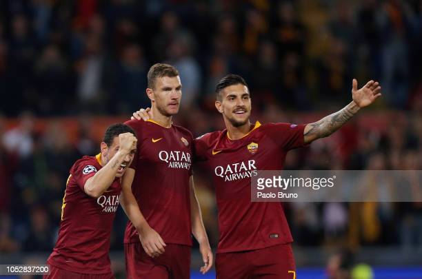 Edin Dzeko of AS Roma celebrates with his teammates after scoring the team's second goal during the Group G match of the UEFA Campions League between...
