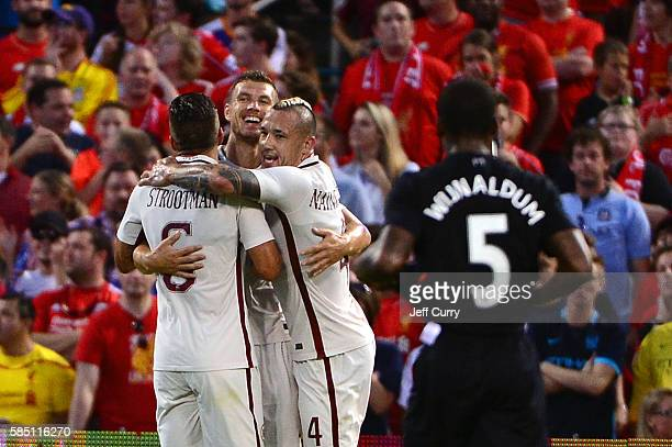 Edin Dzeko of AS Roma celebrates with teammates after scoring a goal against Liverpool FC during a friendly match at Busch Stadium on August 1 2016...
